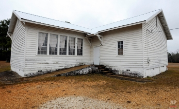 """This Wednesday, Jan. 27, 2016 photo shows the old Mount Sinai Junior High School, a so-called """"Rosenwald School"""" built for rural blacks during the Jim Crow era near Prattville, Ala. Philanthropist Julius Rosenwald spurred the construction of more 5,300 schools for blacks across the South in the early 1900s, but fewer than 450 remain since efforts to save the buildings are spotty. (AP Photo/Jay Reeves)"""