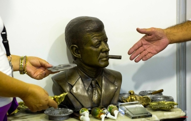 A bronze sculpture of U.S. President John F. Kennedy smoking a cigar, by Cuban artist Ernesto Milanes, sits for sale for $3,500 dollars on the opening day of the annual Havana Cigar Festival in Havana, Cuba, Monday, Feb. 29, 2016. The festival is a five-day bash that brings together cigar sophisticates from around the world and culminates with a gala and auction of humidors worth hundreds of thousands of dollars. (AP Photo/Desmond Boylan)