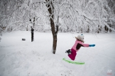 Althea LeBlanc, 9, jumps off a snow bank after a snow storm Friday, Feb. 5, 2016, in Derry, N.H. The storm was New Englandís biggest snowstorm so far this season, coming two weeks after a massive blizzard engulfed much of the Eastern Seaboard but largely spared Boston and points north. (AP Photo/David Goldman)