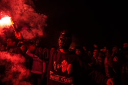 Hardcore fans of Egypt's Zamalek football club hold up flares and chant slogans in Fustat Park, Cairo, Monday, Feb. 8, 2016. Hundreds of soccer fans held a rally inside a Cairo park to commemorate the deaths of 22 people killed in clashes last year between the police and fans of the Zamalek football club. The fans set off firecrackers and waved banners as large numbers of security forces were deployed outside the park. (AP Photo/Belal Wagdy)