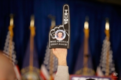 A supporter holds a foam finger sign promoting Republican presidential candidate businessman Donald Trump before he speaks at a primary night rally, Tuesday, Feb. 9, 2016, in Manchester, N.H. (AP Photo/David Goldman)