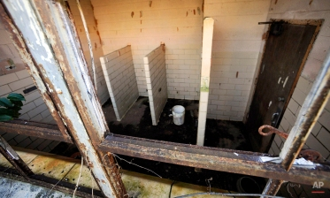 """This Friday, Jan. 29, 2016 photo shows a restroom inside the abandoned Eleanor Roosevelt School at Warm Springs, Ga. The school, named for the former first lady, was one of thousands of so-called """"Rosenwald Schools"""" built to educate rural black across the South during the Jim Crow period of the early 1900s, but today it is in bad disrepair. Some communities have preserved the schools for the sake of history, while others have not. (AP Photo/Jay Reeves)"""