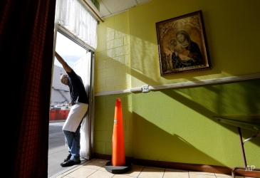 Volunteer Joey Chapman waits at the front door before food was served at the Fraternite Notre Dame Mary of Nazareth Soup Kitchen in San Francisco, Tuesday, Feb. 9, 2016. San Francisco nuns who serve the homeless are in danger of getting kicked out of their home after a rent hike of more than 50 percent. (AP Photo/Jeff Chiu)