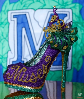 An all-female Mardi Gras parade group known as the Krewe of Muses creates hand decorated shoes from a garage in Kenner, La., Sunday, Jan. 10, 2016. The Krewe of Muses has over 1000 members who ride parade floats. (AP Photo/Max Becherer)