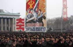 North Koreans gather at the Kim Il Sung Square to celebrate a satellite launch Monday, Feb. 8, 2016, in Pyongyang, North Korea. People in Pyongyang danced and watched fireworks the day after a rocket launch that has been strongly condemned by many countries around the world. (AP Photo/Jon Chol Jin)