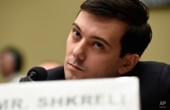Pharmaceutical chief Martin Shkreli listens on Capitol Hill in Washington, Thursday, Feb. 4, 2016, during the House Committee on Oversight and Reform Committee hearing on his former company's decision to raise the price of a lifesaving medicine. Shkreli refused to testify before U.S. lawmakers who excoriated him over severe hikes for a drug sold by a company that he acquired. (AP Photo/Susan Walsh)