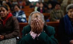 A woman covers her face during prayer at an Ash Wednesday Mass held at the San Francisco church in La Paz, Bolivia, Wednesday, Feb. 10, 2016. Ash Wednesday for Catholics ushers in a period of penitence and reflection, known as the season of Lent, that leads up to Easter Sunday. (AP Photo/Juan Karita)