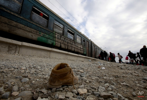 Refugees board a train that will take them towards Serbia, at the transit center for refugees, near the southern Macedonia's town of Gevgelija, Monday, Feb. 8, 2016. European Union nations anxious to stem the flow of asylum-seekers coming through the Balkans are increasingly considering sending more help to non-member Macedonia as a better way to protect European borders instead of relying on EU member Greece. Macedonia started reinforcing the border fence with Greece, doubling it with another fence, which is expected to increase the control of the migrant flow. (AP Photo/Boris Grdanoski)