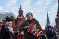 Men play accordions during a folk performance just off Red Square in Moscow, Russia, Wednesday, Feb. 24, 2016. (AP Photo/Alexander Zemlianichenko)