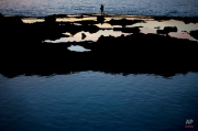 A fisherman fishes on a rocky reef near Achziv on the Mediterranean coast of northern Israel, near the border with Lebanon, Wednesday, Feb. 17, 2016. (AP Photo/Ariel Schalit)