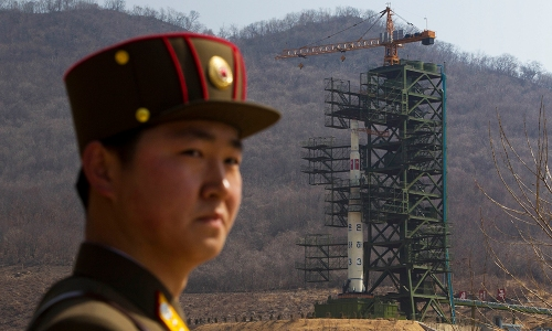 "In this April 8, 2012, file photo, a North Korean soldier stands in front of the Unha 3 rocket at a launching site in Tongchang-ri, North Korea.  The Unha 3 rocket that launched the ""Bright Star"" satellite into space in 2012 is a symbol of North Korea's technological successes and a matter of great national pride. (AP Photo/David Guttenfelder, File)"