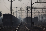 Indian commuters walk between rail tracks in Ghaziabad train station, on the outskirts of New Delhi, India, Wednesday, Feb. 24, 2016. Railway Minister Suresh Prabhu unveils the budget Thursday for India's immense railroad network, once a pride of the Indian government but now hobbled by aging infrastructure. (AP Photo/Bernat Armangue)