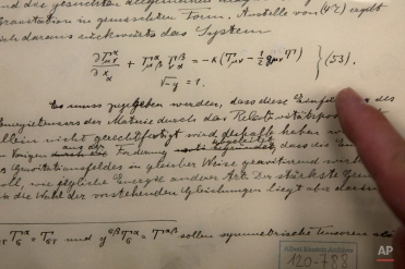 The original historical documents related to Albert Einstein's prediction of the existence of gravitational waves are seen at the Hebrew university in Jerusalem, Thursday, Feb. 11, 2016. In a blockbuster announcement, scientists said Thursday that after decades of trying they have detected gravitational waves, the ripples in the fabric of space-time that Einstein predicted a century ago. (AP Photo/Sebastian Scheiner)