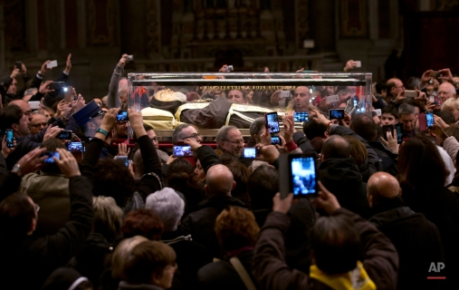 The box containing the corpse of Saint Pio da Pietralcina is carried inside St. Peter's Basilica at the Vatican, Friday, Feb. 5, 2016. Saint Pio is widely venerated in Italy and abroad. He is famous for bearing the stigmata, which are the marks of Christ, and was canonized by Pope John Paul II in 2002. He died on Sept. 23, 1968. (AP Photo/Alessandra Tarantino)