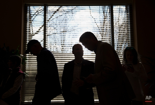 Crowd members wait in line to enter a campaign event for Republican presidential candidate, Sen. Marco Rubio, R-Fla., at the InterContinental Hotel Monday, Feb. 29, 2016, in Atlanta. (AP Photo/David Goldman)