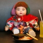 """In this Friday, Jan. 29, 2016 photo, a """"child angel"""" doll is offered food by its owner Supavadee Tapmalai at a Japanese restaurant in Bangkok. The dolls, which are said to bring good luck to their owners, became a media sensation this week after a leaked memo from a Thai budget airline gave pointers on how they could be treated like passengers if they have a paid-for seat. Thai people are superstitious, and the doll phenomenon has been analyzed as a modern version of a traditional totem containing real body parts, but as a fad it seems have more in common with Furby dolls. (AP Photo/Sakchai Lalit)"""