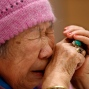 Kang Il-chul, a South Korean woman abused by Japan's wartime military-run brothel system, cries as she speaks at a press conference in Tokyo, Tuesday, Jan. 26, 2016. Two South Korean women, Kang, 87, and Lee Ok-sun, 88, are in Japan to reject a recent settlement agreement between the two governments and demand that Prime Minister Shinzo Abe give them a face-to-face apology and formal compensation. (AP Photo/Shizuo Kambayashi)