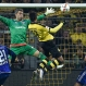 Dortmund's Pierre-Emerick Aubameyang, second right, scores his first goal with his head against Ingolstadt's goalkeeper Ramazan Ozcan, second left, during the German Bundesliga soccer match between Borussia Dortmund and FC Ingolstadt in Dortmund, Germany, Saturday, Jan. 30, 2016. (AP Photo/Martin Meissner)