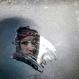 A woman looks through an icy window in a bus in Ukraine's capital in Kiev, Monday, Jan. 4, 2016. (AP Photo/Sergei Chuzavkov)
