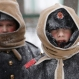 Pupils of Navy cadet classes walk in snow in St. Petersburg, Russia, Tuesday, Jan. 12, 2016. Low temperatures caused the two-days of snowfall in St.Petersburg. (AP Photo/Dmitry Lovetsky)