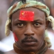 A traditional Zimbabwean dancer wears a sticker of a China flag on his forehead during Chinese New Year celebrations in Harare, Sunday, Jan. 17, 2016. The Chinese Community in Zimbabwe got together with Zimbabweans to celebrate their New Year by holding a carnival and various exhibitions as part of their initiative for a cross cultural communication platform. (AP Photo/Tsvangirayi Mukwazhi)