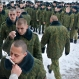 Servicemen of the Belarus Interior Ministry's special unit lineup to kiss an Orthodox cross after an Orthodox Christmas service at their military base in Minsk, Belarus, Thursday, Jan. 7, 2016. Belarus Orthodox believers celebrate Christmas by the Julian calendar on Jan. 7. (AP Photo/Sergei Grits)