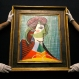Sotheby's employees adjust a painting by Pablo Picasso called 'Tete de Femme' at the auction rooms in London, Thursday, Jan. 28, 2016. The painting is estimated at 16-20 million pounds (US $23-29 million) when it goes up for auction in London on Feb. 3. in the Impressionist and Modern Art Evening Sale. (AP Photo/Kirsty Wigglesworth)