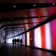 Pedestrians walk through a tunnel at Kings Cross Underground station, past the artwork called 'Pipette-Kings Cross Tunnel' by the artists Miriam Sleeman, Tom Sloan, Allies & Morrison, Speirs and Major, part of the Lumiere Festival in London, Friday, Jan. 15, 2016. Lumiere London is a festival of lights across 30 London locations, showing installations, projections and interactive pieces. The festival runs until Jan. 17. (AP Photo/Kirsty Wigglesworth)