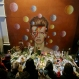 People gather next to tributes placed near a mural of British singer David Bowie by artist Jimmy C, in Brixton, south London, Monday, Jan. 11, 2016. Bowie, the other-worldly musician who broke pop and rock boundaries with his creative musicianship, nonconformity, striking visuals and a genre-spanning persona he christened Ziggy Stardust, died of cancer at the age of 69. He was born in Brixton. (AP Photo/Tim Ireland)