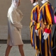 Princess Charlene of Monaco walks past Swiss guards as she arrives with Prince Albert II of Monaco to attend a private audience granted by Pope Francis, at the Vatican, Monday, Jan. 18, 2016. (AP Photo/Alessandra Tarantino)