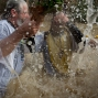 A Christian Orthodox priest reenacts the baptism of Jesus, during the traditional Epiphany baptism ceremony at the Qasr-el Yahud baptism site in the Jordan River near the West Bank town of Jericho, Monday, Jan. 18, 2016. The site is traditionally believed by many to be the place where Jesus was baptized. (AP Photo/Ariel Schalit)