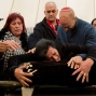 """Nitza Bakal, mother of Alon Bakal, who was killed when a gunman opened fire at a bar in Tel Aviv on Friday, mourns over his body during his funeral in Carmiel, northern Israel, Sunday, Jan. 3, 2016. Israeli police are on """"heightened alert"""" as they continue the manhunt for a gunman who killed two people and wounded several others. (AP Photo/Ariel Schalit)"""