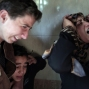 Relatives of Palestinian Moussa Zuaiter, 24, weep in the family house during his funeral in the Jabaliya refugee camp, northern Gaza Strip, Wednesday, Jan. 13, 2016. Zuaiter was killed by an airstrike that the Israeli military said it carried out against a group of Gaza militants placing explosives along the border. (AP Photo/ Khalil Hamra)