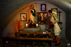 In this photo taken Saturday, May 30, 2015, Spanish bullfighter Enrique Ponce prays inside the bullring's chapel before a bullfight with Alcurrucen ranch fighting bulls in Aranjuez, near Madrid, Spain. Bullfighting is an ancient tradition in Spain. (AP Photo/Daniel Ochoa de Olza)