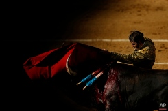 Spanish bullfighter Juan Jose Padilla performs during a bullfight of the San Isidro fair Madrid, Spain, Friday, May 22, 2015. San Isidro's bullfighting fair is one of the most important in the world. Bullfighting is an ancient tradition in Spain. (AP Photo/Daniel Ochoa de Olza)