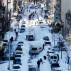 People clear snow from parked cars on Henry Street in the Chinatown neighborhood in New York on Sunday, Jan. 24, 2016. Millions of Americans began digging out Sunday from a mammoth blizzard that set a new single-day snowfall record in Washington and New York. (AP Photo/Peter Morgan)