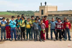 Syrian children pose for a picture in Maarzaf, about 15 kilometers west of Hama, Syria, Wednesday, March 2, 2016. Local leaders and elders sign a declaration pledging to abide by a truce in Maarzaf. The Russian military has helped mediate signing the document. (AP Photo/Pavel Golovkin)
