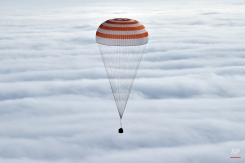 Russia's Soyuz TMA-18M space capsule carrying the International Space Station (ISS) crew members prepares to land in a remote area outside the town of Dzhezkazgan, Kazakhstan, Wednesday, March 2, 2016. U.S. astronaut Scott Kelly and Russian cosmonaut Mikhail Kornienko returned to Earth on Wednesday after spending almost a year in space in a ground-breaking experiment foreshadowing a potential manned mission to Mars. (Krill Kudryavtsev/Pool Photo via AP)