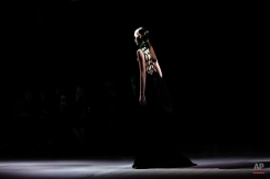 A model wears a creation for Dries Van Noten's fall-winter 2016-2017 ready to wear fashion collection presented Wednesday, March 2, 2016 in Paris. (AP Photo/Thibault Camus)