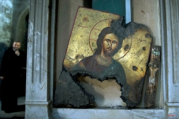 A half-burned image of Christ is placed next to a wall at a Greek Orthodox church in Maaloula, Syria, Thursday, March 3, 2016. Maaloula, an ancient Christian town 60 kilometers (40 miles) northeast of Damascus, changed hands several times in the war. Its historic churches pillaged by jihadis and buildings riddled with shrapnel reflect fierce fighting that devastated the town two years ago. (AP Photo/Pavel Golovkin)