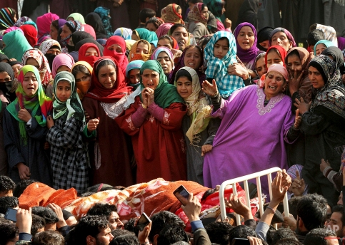 Kashmiri women villagers wail as they watch the body of Asif Ahmad, a suspected rebel, during his funeral procession in Dadsar village, 40 kilometers (25 miles) south of Srinagar, Indian controlled Kashmir, Thursday, March 3, 2016. Three Kashmiri rebels were killed in a gunbattle with government forces early Thursday as they tried to break through a security cordon in the disputed Himalayan region of Kashmir, the army said. Hundreds of residents chanting pro-freedom slogans tried to reach the site of the gunbattle in a show of solidarity with the militants. Police fired tear gas late Wednesday and Thursday to disperse them. (AP Photo/Mukhtar Khan)