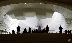 Pedestrians walk inside the Oculus Thursday, March 3, 2016, in New York. New Yorkers and tourists get their first look inside the cathedral-like hall that sits atop the new $4 billion train station at the World Trade Center. (AP Photo/Frank Franklin II)
