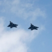 Four U.S. F-22 stealth fighters fly over Osan Air Base in Pyeongtaek, South Korea, Wednesday, Feb. 17, 2016. Four U.S. F-22 stealth fighters flew over South Korea on Wednesday in a clear show of power against North Korea, a day after South Korea's president warned of the North's collapse amid a festering standoff over its nuclear and missile ambitions. (AP Photo/Lee Jin-man)