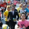 A man in business suit joins other runners during the Tokyo Marathon in Tokyo, Sunday, Feb. 28, 2016. About 37,000 people participated in the annual sport event. (AP Photo/Shizuo Kambayashi)