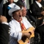 In this Feb. 13, 2016 photo, a musician plays for Pope Francis along his route to the Basilica of the Virgin of Guadalupe in Mexico City. The pontiff's five-day visit includes a prayer before the Virgin of Guadalupe shrine, the largest and most important Marian shrine in the world and one that is particularly important to the first Latin American pope. (AP Photo/Moises Castillo)