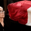 Laila Boutros-Ghali, the wife of former U.N. Secretary-General Boutros Boutros-Ghali, sits near his coffin during his funeral in Al-Boutrossiya Church, at the main Coptic Cathedral complex in Cairo, Egypt, Thursday, Feb. 18, 2016. Boutros-Ghali, a veteran Egyptian diplomat who helped negotiate his country's landmark peace deal with Israel but then clashed with the United States when he served a single term as U.N. secretary-general, died Tuesday, Feb. 16, 2016, aged 93. (AP Photo/Nariman El-Mofty)