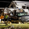 First responders search the remains of trailers and vehicles at the Sugar Hill RV Park in Convent, La., Tuesday, Feb. 23, 2016. St. James Parish Sheriff Willy Martin says authorities are using dogs to search piles of rubble left in the wake of the storm to find anyone else still missing under the debris. (AP Photo/Max Becherer)