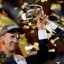 Denver Broncos' Peyton Manning holds up the trophy after the NFL Super Bowl 50 football game Sunday, Feb. 7, 2016, in Santa Clara, Calif. The Broncos won 24-10. (AP Photo/Matt York)