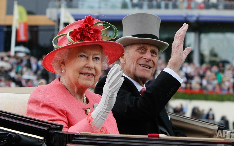 Britain's Queen Elizabeth II with Prince Philip arrive by horse drawn carriage in the parade ring on the third day, traditionally known as Ladies Day, of the Royal Ascot horse race meeting at Ascot, England, Thursday, June, 16, 2011. Ascot  is celebrating its 300 years of horse racing at the Royal Racecourse, that began with Britain's Queen Anne spotting an open heath suitable for racing, the first race run in August 1711, with a prize of some 100 guineas. (AP Photo/Alastair Grant)