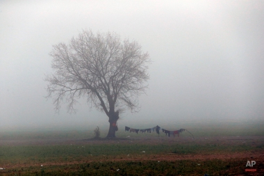 An early morning fog at the makeshift camp at the northern Greek border point of Idomeni, Greece, Monday, April 4, 2016. A plan to send back migrants from Greece to Turkey sparked demonstrations by local residents in both countries days before the deal brokered by the European Union is set to be implemented. (AP Photo/Amel Emric)
